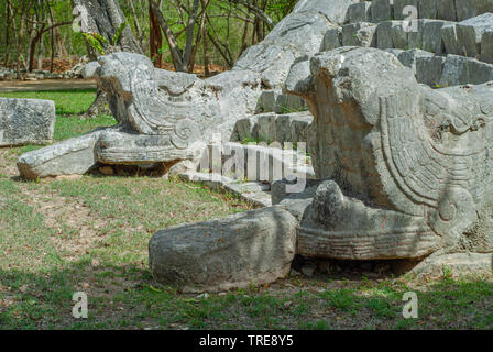 Entrance stairs of a Mayan pyramid, depicting two stone snakes on the sides, in the archaeological area of Chichen Itza, on the Yucatan peninsula - Stock Photo