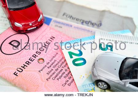 German and EU driving licenses and model cars - phased plan to renew driving license - Stock Photo