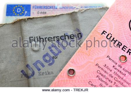 German driving licenses with stamp INVALID - phased plan to renew driving license - Stock Photo
