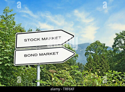 Road signs to bond market and stock market - Stock Photo