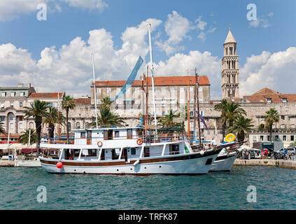 Excursion Boats, Waterfront, Split, Croatia. Diocletion's Palace is in the background. - Stock Photo