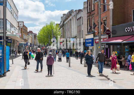 Shoppers shopping in Dudley Street in the centre of Wolverhampton, UK - Stock Photo