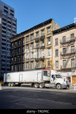 New York, USA - June 30, 2018: Semi trailer truck parked on a street of Manhattan. - Stock Photo