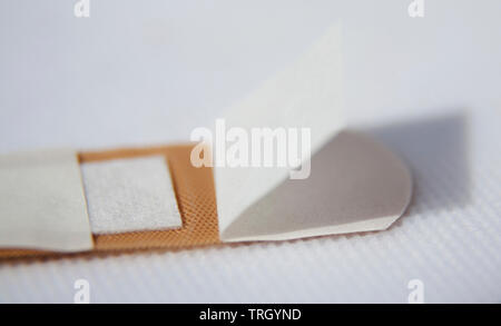 opened patch on white background - Stock Photo