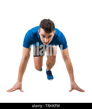 Determined caucasian man runner standing in running position looking ahead confident. Young guy sprinter wearing black and blue sportswear. - Stock Photo