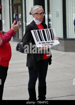 Protester standing outside the State of New York State Board of Elections Prepare to Address the Board Against Hybrid Voting Machines. - Stock Photo
