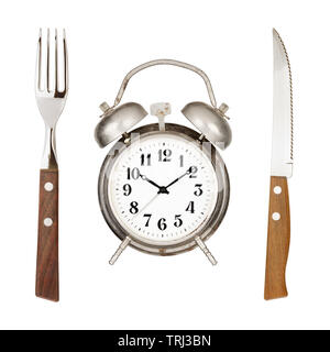 Eating time concept. Alarm clock, knife and fork isolated on white backround - Stock Photo