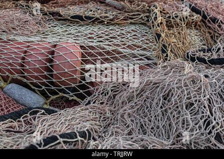 Fishinig net with buoys close view - Stock Photo