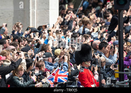 London, UK. 8th June 2019. Members of the Royal Family celebrate Trooping the Colour at Buckingham Palace. Her Majesty The Queen rode in a carriage alone, while The Duke and Duchess of Sussex shared a carriage with The Duchess of Cambridge and The Duchess of Cornwall. Credit: Benjamin Wareing/Alamy Live News - Stock Photo