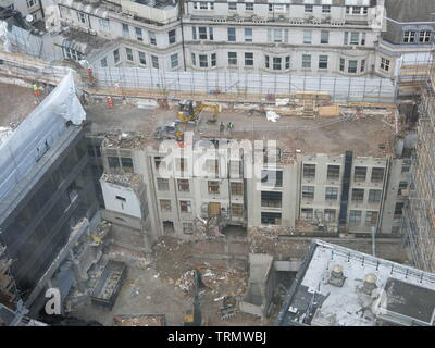 BREXIT delays have not hindered the construction industry at this site in central London where demolition of a multi-storey building is well underway - Stock Photo