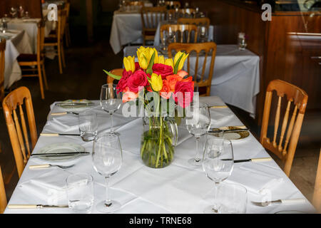 Flowers on a table in the twofatladies restaurant on Blythswood Street in Glasgow city centre, Scotland, UK - Stock Photo