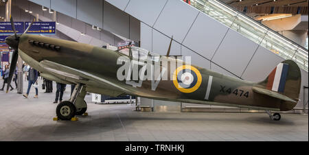 London, UK. 31st May 2019. A full-sized replica Spitfire aircraft is unveiled on the station concourse at London Bridge Station by the Imperial War Museum (IWM) to mark 75 years since D-Day. The Spitfire provided essential air support for the D‐Day landings as a fighter‐bomber. Credit: Guy Corbishley/Alamy Live News - Stock Photo