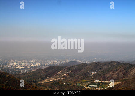 View of Almaty from above with clearly seen sea of smog - Stock Photo