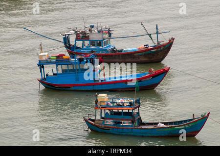 Nha Trang Vietnam, local wooden fishing boats moored in river - Stock Photo
