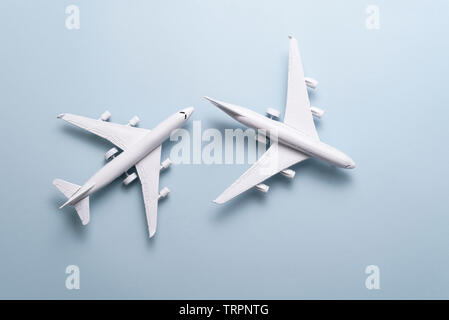 Two passenger planes, vacation concept. Pastel color background, Top view for copy space, some idea your create destination and Travel around the worl - Stock Photo