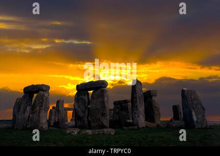 Amesbury,ancient,Solstice, Sunrise,sun,beams,Neolithic, Stone, Circle, Stonehenge, Wiltshire, England, UK, - Stock Photo