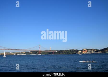 The Ponte 25 de Abril suspension bridge over Tagus River, Lisbon, Portugal, June 2019 - Stock Photo