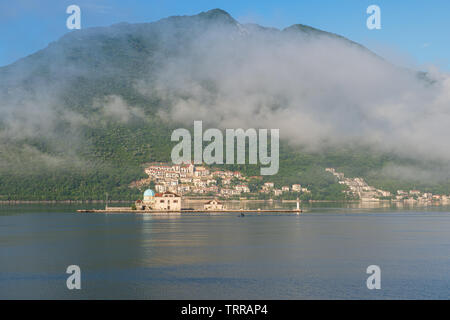 Our Lady of the Rocks is one of the two islets off the coast of Perast in Bay of Kotor, Montenegro. It is an artificial island created by bulwark of r - Stock Photo