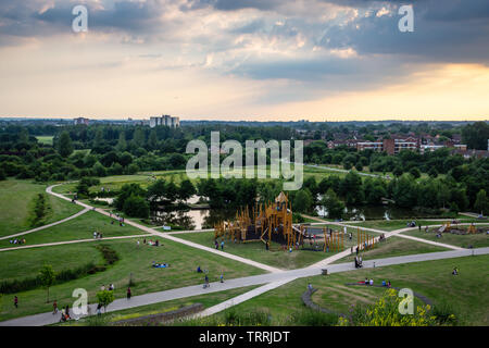 London, England, UK - June 18, 2017: Families play at a playground in Northala Fields park in Ealing, west London. - Stock Photo