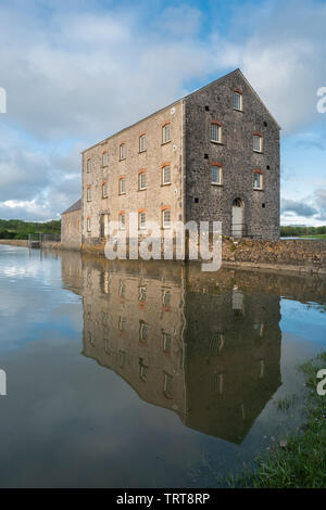 Carew Tidal Mill and millpond, the only restored tidal mill in Wales, built in the early 19th century, Pembrokeshire, Wales, UK - Stock Photo