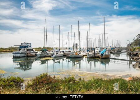 Marina Harbor, Morro Bay, California. Boats, Reflection, Cloudy Blue Sky in Background - Stock Photo