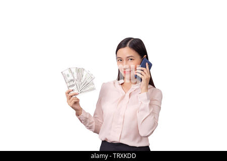 Asian beautiful woman holding banknote money in hand and mobile phone in another hand isolated on white background with clipping path.  commercial bus - Stock Photo