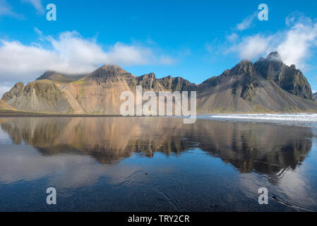 Icelandic landscape, reflection of Vestrahorn mountain in the waters of the Atlantic ocean. Stokksnes peninsula, Hofn, Iceland - Stock Photo