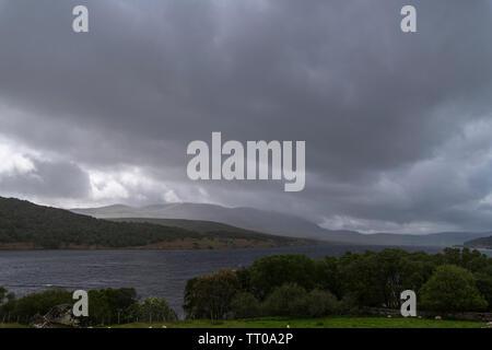 Squally rain over Ben Klibreck and Loch Naver near Altnaharra in Sutherland, Scotland. 3rd June 2019 - Stock Photo