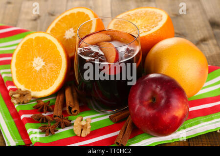 Fragrant mulled wine in glass on napkin close-up - Stock Photo
