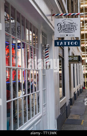 Johnny's Chop Shop, a mens barber shop and tattoo parlour in Marshall Street, Soho, London - Stock Photo