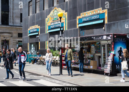 People in Great Marlborough Street use the pedestrian crossing near the Spaghetti House Italian restaurant - Stock Photo