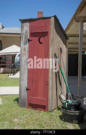 Pioneer Days small town annual celebration in North Central Florida.  Wooden outhouse sits outside the historical museum, High Springs, FL. - Stock Photo