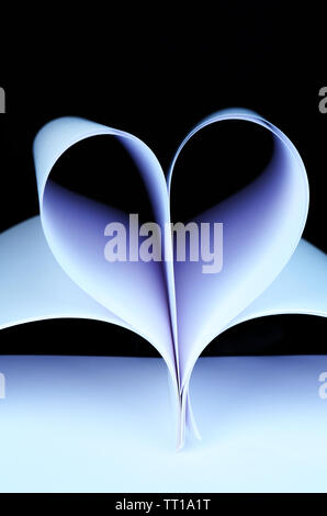 White paper in shape of heart on black background close-up - Stock Photo