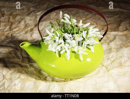 Composition with beautiful snowdrops in vase  on  dark background - Stock Photo