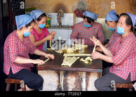 Group of Woman Rolling  Twisted Pretzels, Yuanjia Village, Xaanxi, China - Stock Photo