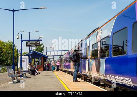 Passengers boarding a Northern Rail class 158 passenger train at Brough railway station, Yorkshire, London. - Stock Photo