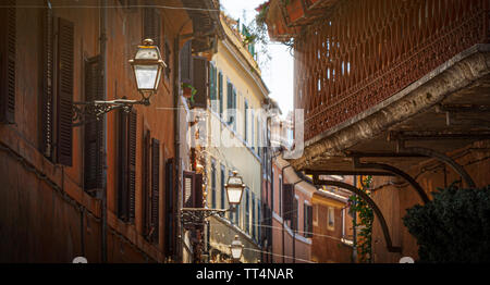 glimpse of an alley of Trastevere in Rome with ancient buildings. concept of travel and tourist destinations - Stock Photo