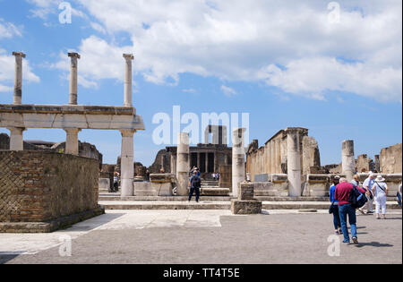 Tourists in the forum of the ancient Roman town of Pompeii in Campania near Naples in Southern Italy - Stock Photo