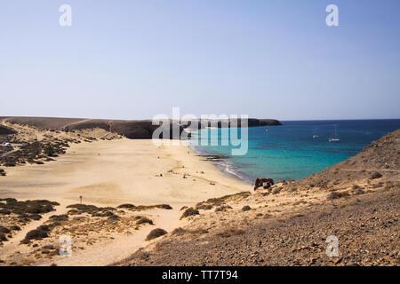View from steep cliff into blue lagoon beach - Playa Papagayo, Playa Blanca - Lanzarote - Stock Photo