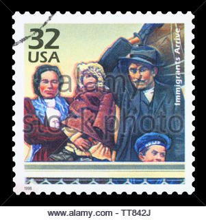 UNITED STATES OF AMERICA - CIRCA 1998: a postage stamp printed in USA showing an image of an immigrant family, circa 1998. - Stock Photo