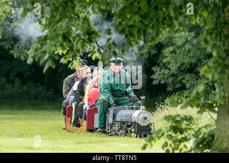 A miniature steam train engine ride in Leyland park, Lancashire, UK - Stock Photo