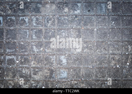 Gray and aged cement floor in an abandoned place - Stock Photo