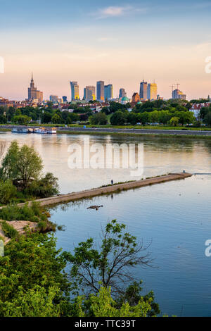 City of Warsaw river view at sunset in Poland. - Stock Photo