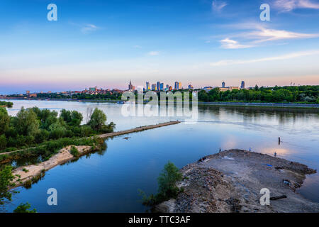 Vistula River and Warsaw skyline at blue hour twilight, capital city of Poland. - Stock Photo