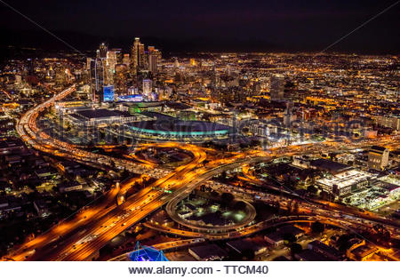 Intersection of I-10 and I-110 with the Convention Center and the City of Los Angeles in the background. - Stock Photo