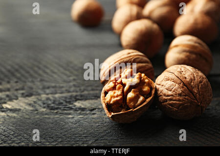 Walnuts on grey wooden table - Stock Photo