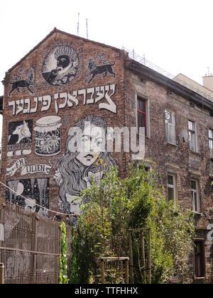 Street art mural by Broken Fingaz in Cracow, Poland - Stock Photo