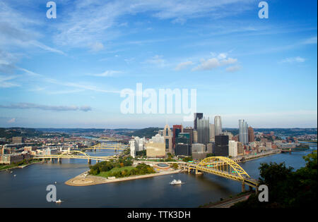 High angle view of bridges over river in Pittsburgh city against blue sky - Stock Photo