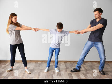 Family problems concept. Little boy between parents - Stock Photo