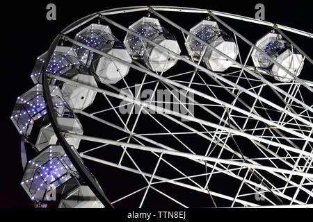 Newport, Isle of Wight - June 16 2019: Isle of Wight Festival Fairground ride, Ferris Wheel at night. - Stock Photo